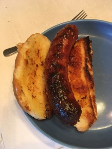 perfectly grilled bratwurst with garlic toasted bun