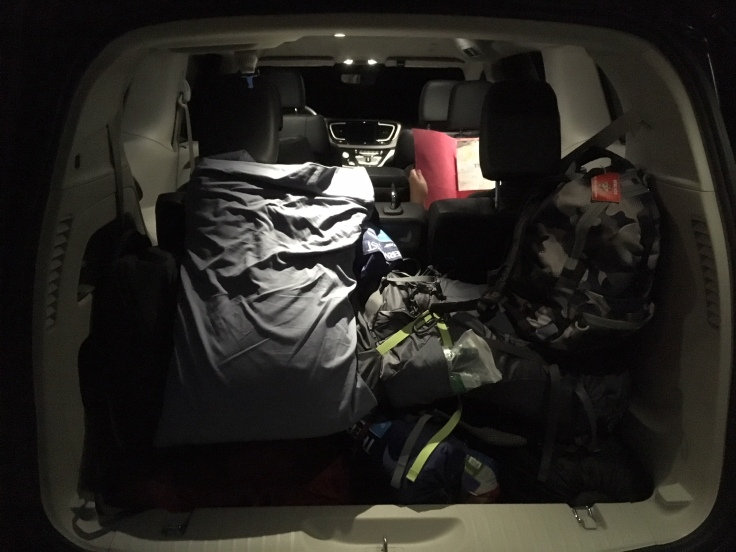 Van packed for camp in early morning