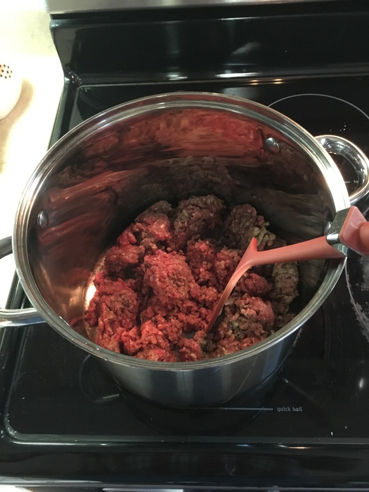 Browning ground beef in stew pot