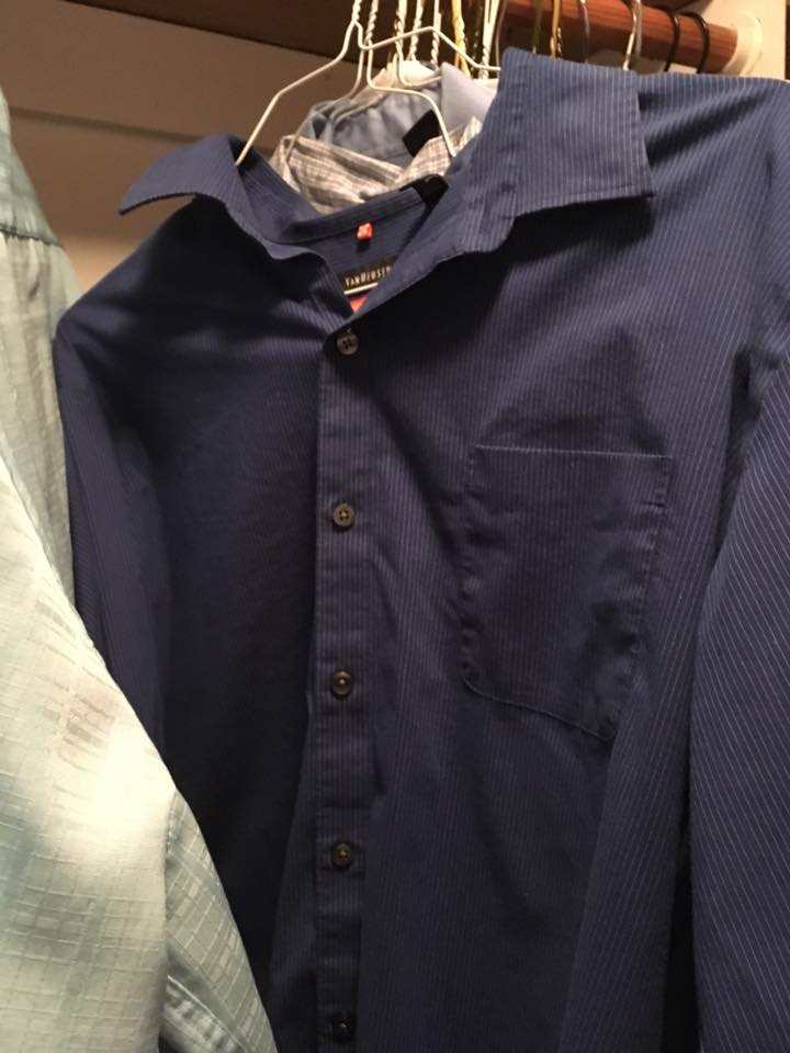 Tedious: A hanging shirt buttoned all the way