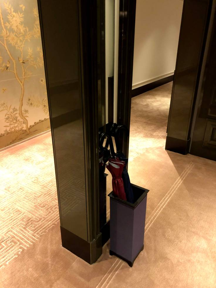 Umbrella stand outside room at Rosewood Hong Kong