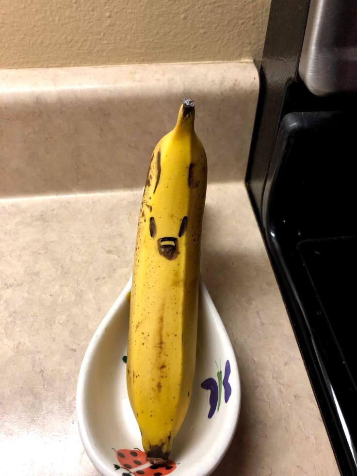Random smiling banana in spoon tray in kitchen