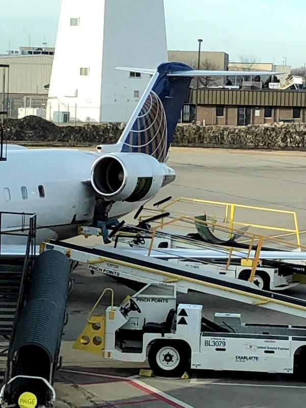 Airplane under repair at gate United Airlines